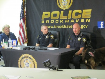 From left, Holly Cripps of We Ride to Provide and Brookhaven officers Russell Chatham, John Ritch and Grizz.
