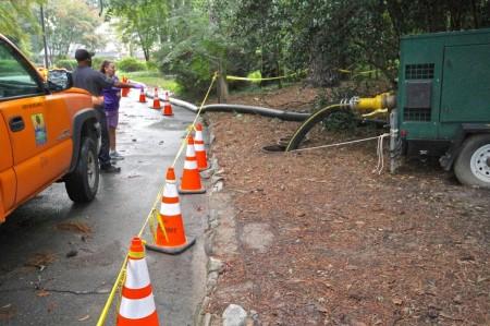 Crews make repairs to the sewage pipe over Peachtree Creek at Atlanta Memorial Park.
