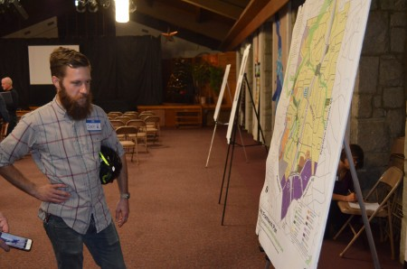 Joey Wilkinson examines a proposed plan for the North Buckhead neighborhood during a community meeting at  St. James United Methodist Church.