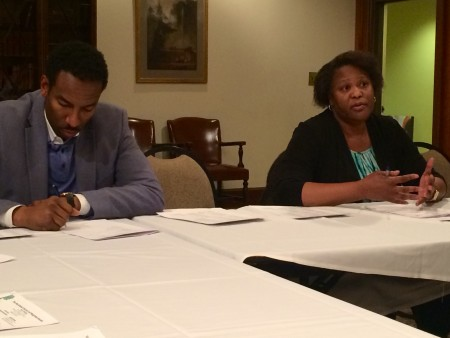 Atlanta City Council members Andre Dickens, left, and Felicia Moore discuss the city's debt to the Atlanta Public Schools at the Buckhead Council of Neighborhood's meeting.