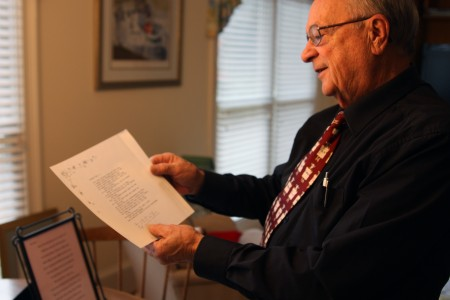 Gene Vezina shows off a poem he wrote to his wife Kay on their wedding day 56 years ago. Now she's in an assisted living home and he's found new support working at a Chick-fil-A restaurant in Dunwoody.