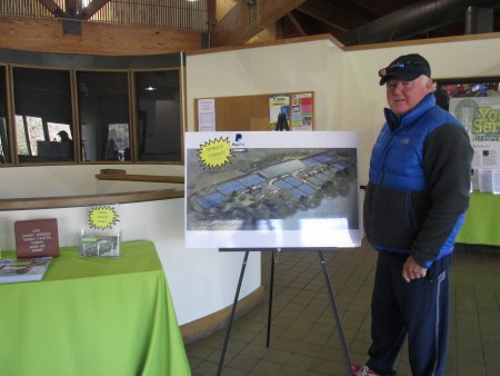 Gerry Groslimond looks at renderings of covered courts at the Sandy Springs Tennis Center.