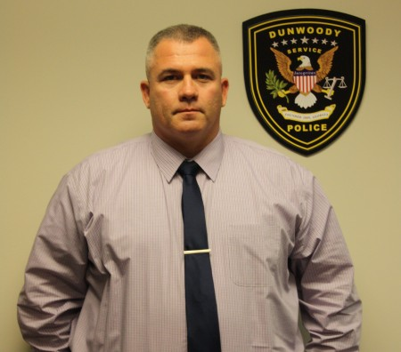 """Now a detective, Robert Barrett was voted """"Officer of the Year"""" by his fellow Dunwoody police officers for 2014. Barrett also won the award in 2010."""