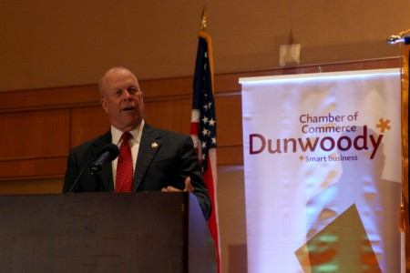 Dunwoody Mayor Mike Davis updates the community Feb. 12 during the annual State of the City address at the Crowne Ravinia hotel in Dunwoody.