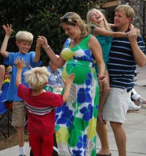 A family enjoys the music at  last year's Concerts by the Springs series.