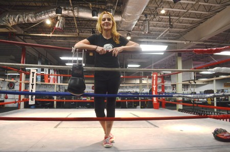 Terri Moss in teh boxing ring in her gym, the Buckhead Fight Club.