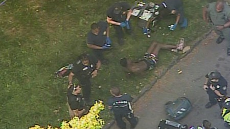 This image courtesy CBS46 shows the APD apprehending the two robbery suspects.