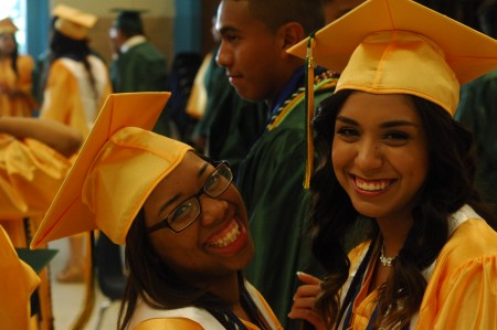 Jessica Encarnacion, left, with Monserrat Reyes-Rubio, are all smiles as they prepare for the Cross Keys High School commencement ceremony in Adams Stadium on May 22.