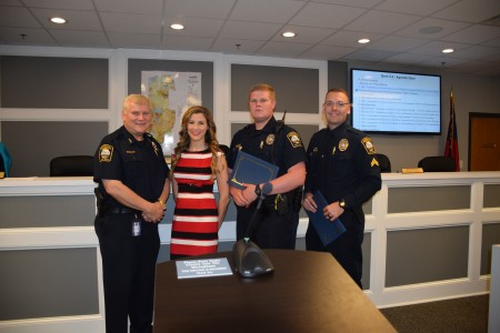 Left to right: Brookhaven Police Chief Gary Yandura with Officers Maria Gresham and P. McIntosh and Cpl. J. Kissel.