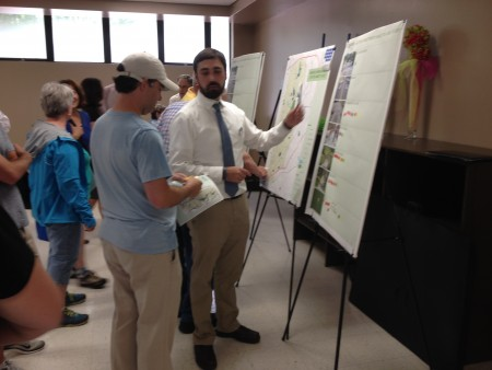 During a meeting at Lynwood Park, Graham Malone, right, of Pond and Company describes proposals for a series of bike and pedestrian trails in Brookhaven.