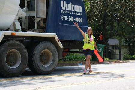 Gaytha Burg directs traffic along the 1800 block of Mount Vernon Highway in Dunwoody. Photo by Ellen Eldridge.