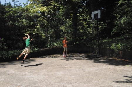 Nicholas Schramkowski, left, and brother Jack, play basketball at their home in Argonne Forest.