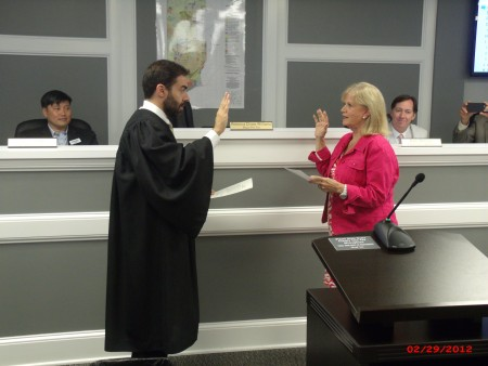 Rebecca Chase Williams is sworn in by State Court Judge Mike Jacobs as Brookhaven's second mayor in history.