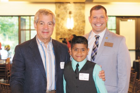 Left, volunteer Les Fuchs and student Sair Banos, with Lake Forest Elementary School Principal Harvey Oaxaca. Fuchs and Banos were part of the Reading Buddies program, created by the Sandy Springs Education Force. Through the program, a volunteer reads with a student 30 minutes each week.