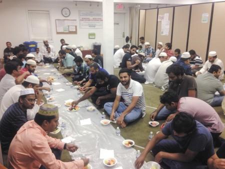 Men gather at Masjid Uthman in Dunwoody to celebrate Ramadan.