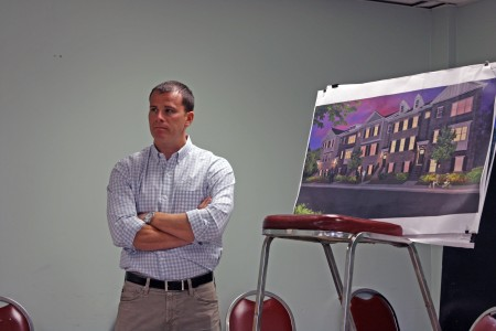 Nevel Allison of Acadia Homes stands in front of an illustration showing planned townhomes at a presentation given to Dunwoody Homeowners Association July 12.
