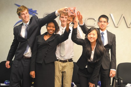 """SpaceWorks interns, left to right, Nick Becker, Ty'Niyah Harris, Alex Rogers, Jennifer Wang and Nathan Smith hold aloft their """"cubesat."""""""
