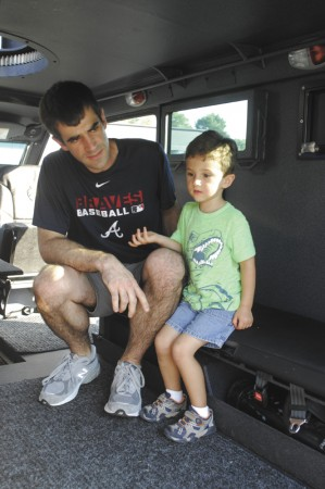 Andrew Perry, and his son Samuel, 3, view the inside of a SWAT truck.
