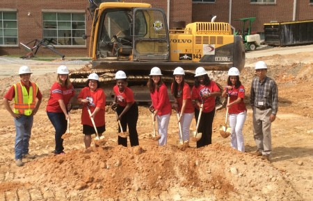 Morris Brandon Principal Kara Stimpson, fifth from left, was joined by Tiffany Momon, Tameka Small, Danny Gutlay, Tracey Hudson, Therese Halligan, Ellen Kenimer and Ann Gabbert at a groundbreaking ceremony in July.