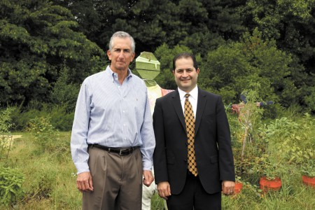 """Jewish Family & Career Services President John Perlman and CEO Rick Aranson in the current Giving garden. The nonprofit plans to move the garden and erect an 8,000-square-foot """"Tools for Independence Building"""" in 2016."""