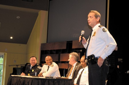 Atlanta police Maj. Van Hobbs addresses the crowd during a Sept. 10 community meeting while, seated, left to right, Deputy Chief Joe Spillane, Chief George Turner, Police Foundation President Dave Wilkinson and Assistant Chief Shawn Jones, listen.