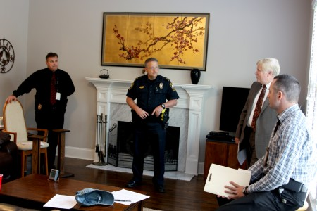 Cpl. Tom Martin, Major Donald Chase, Chief Gary Yandura and Detective Jeffery Gant update a neighborhood watch group Sept. 2 about crime in their area.