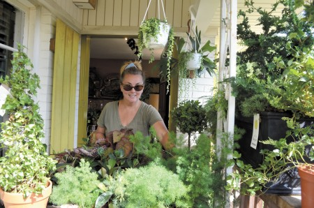 Above, Lisa Bartlett, owner of a landscaping and decorating shop in Sandy Springs called Gramma B's, has had a booth at the Elegant Elf marketplace since its first year. This year the marketplace is offering live performances, and Bartlett will take to the stage to demonstrate holiday wreath decorations.