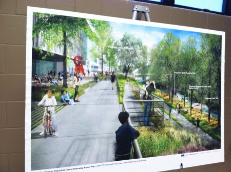"A draft image of potential Peachtree Creek Greenway at Brookhaven trails show at the Oct. 22 meeting, with the ""urban promenade"" at left overlooking other types of trails."