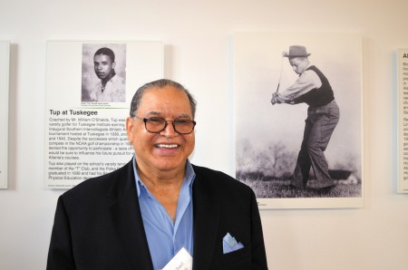 """Michael Holmes stands with a photo of his father, golfer Alfred """"Tup"""" Holmes, that is included in a new exhibit at the Bobby Jones Golf Course."""