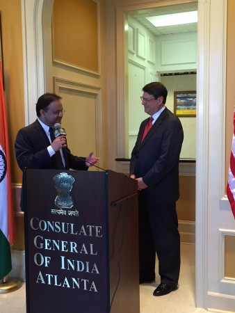 Indian Consul General Nagesh Singh (left) speaks as Sandy Springs Mayor Rusty Paul looks on during a celebration of Diwali at the Indian consulate in Sandy Springs Nov. 11.