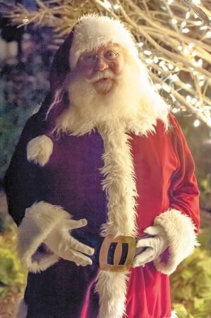 Santa greets visitors to the Atlanta History Center's Candlelight Nights, being presented Dec. 11 and 18. (Photo credit: Bonnie M. Moret/Atlanta History Center)