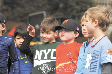 """From left, Jake Yamada, Brady Huesken, Charlie Suddath, Pearson Powell and Witt Grebe, members of the Northside Youth Organization baseball team """"Giants,"""" get ready for practice at Chastain Park in Buckhead on Feb. 28."""