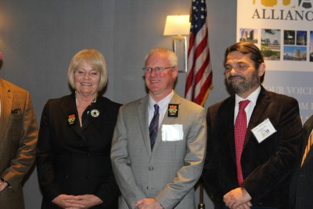 (from left) PCIDs President and CEO Yvonne Williams; GDOT Commissioner Russell McMurry; and Jose Penalver of North Perimeter Contractors team member Ferrovial Agroman US Corp. pose after the Dec. 11 Perimeter Business Alliance luncheon in Dunwoody. (Photo John Ruch)