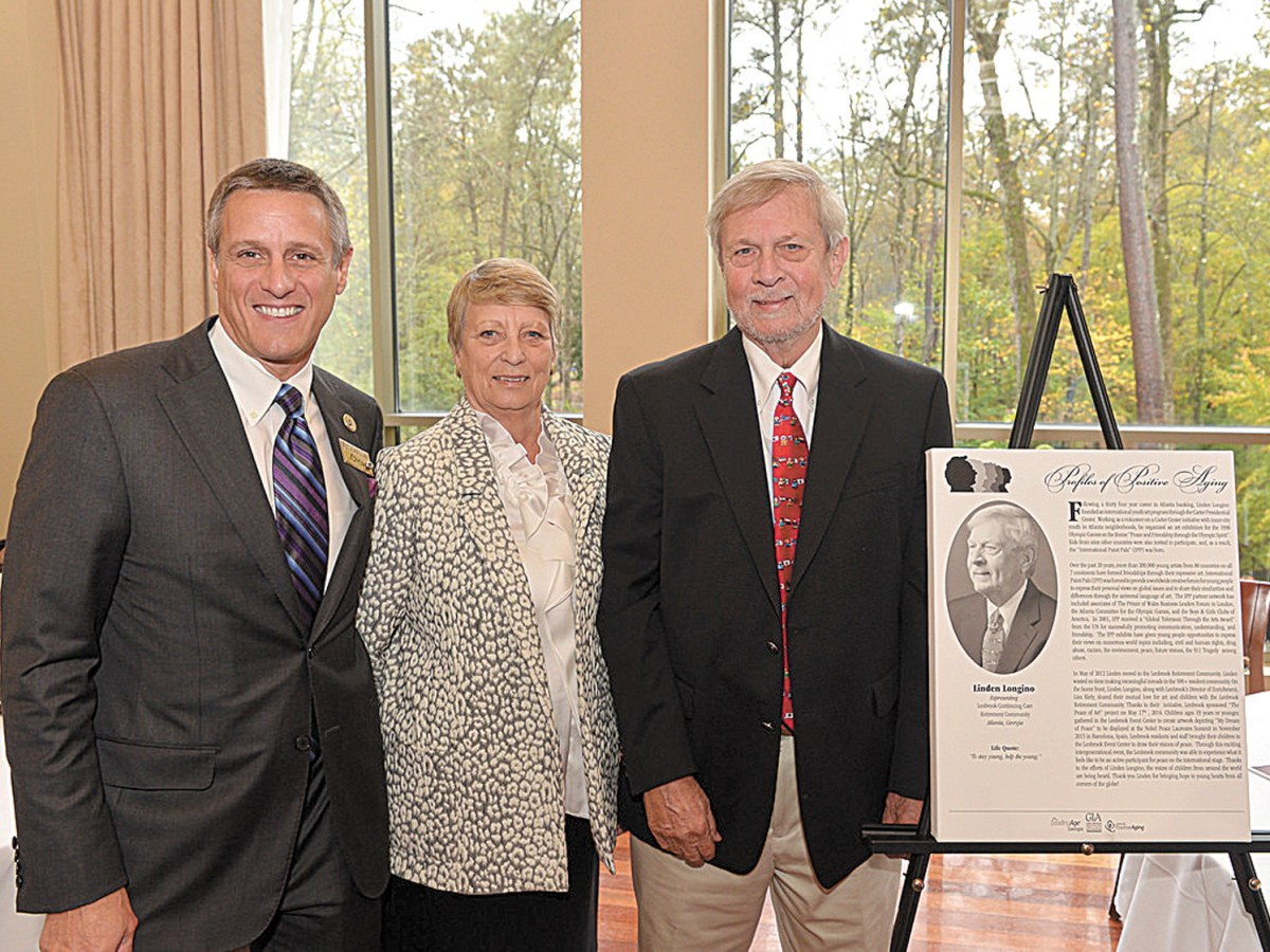 "Linden Longino, right, was honored by LeadingAge Georgia as an example of ""positive aging"" and for his longtime leadership of International Paint Pals. Joining him, at left, Chris Keysor, president and CEO of Lenbrook, a resident senior community in Buckhead, and Jackie Durant, also of Lenbrook."