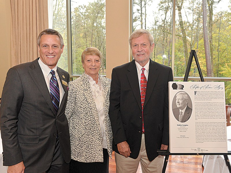"""Linden Longino, right, was honored by LeadingAge Georgia as an example of """"positive aging"""" and for his longtime leadership of International Paint Pals. Joining him, at left, Chris Keysor, president and CEO of Lenbrook, a resident senior community in Buckhead, and Jackie Durant, also of Lenbrook."""