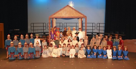 "Pace Academy's first-grade students portrayed historical figures in ""Light One Candle,"" a retelling of the Hanukkah and Christmas stories."