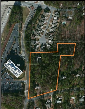 An aerial image of the Roberts Drive site with the property's boundary outlined, from the Roberts Drive Townhomes LLC filing.