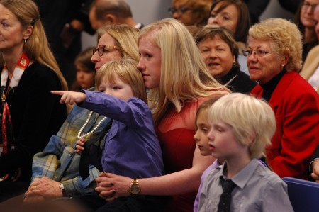Monica Ernst, wife of new Brookhaven mayor John Ernst, and their children attended the ceremonies Jan. 4 to swear Ernst and other city officials into office for a new term. Evan Ernst, 3, points toward the podium during the swearing in of City Councilwoman Linley Jones, as Avery Clockadale, 7, and Jack Ernst, 5, watch.