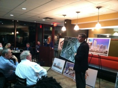 John Walker of Kimley-Horn explains traffic issues to attendees, while project attorney Jessica Hill looks on, at the Jan. 20 community meeting about the 1117 Perimeter Center West redevelopment, held at the project site. (Photo John Ruch)