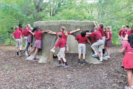 """Photos by Debbie Reams Fifth graders from Holy Innocents' Episcopal School take the measure of a structure at the Chattahoochee Nature Center in Roswell. They're designing a """"destination"""" treehouse for the center."""