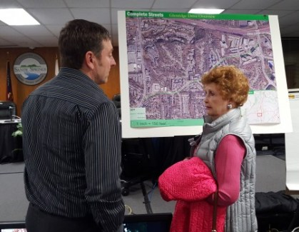 Robert Ping (left), executive director of the Walkable and Livable Communities Institute, listens to Glenridge Drive resident Carol Thorup's concerns at the Feb. 17 Sandy Springs City Hall meeting. (Photo John Ruch)