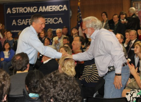 "Ohio Gov. John Kasich (left) shakes hands with Sandy Springs City Councilman Tibby DeJulio after asking him about the city's ""Uber-ization"" of government at the Feb. 23 town hall. (Photo John Ruch)"