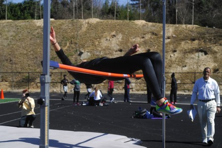 Below, Chamblee Charter High School senior Elana Brown-Soler takes to the air during the high jump.