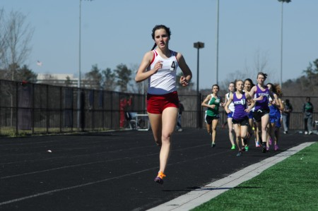 Ansley Heavern, a Dunwoody High School senior, breaks free of the pack during the 1-mile race.