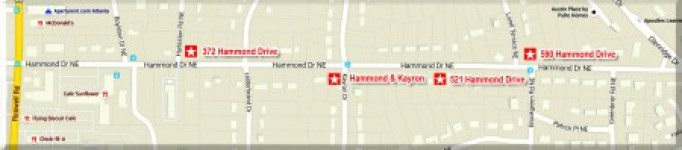 The city has purchased three lots on Hammond Drive and owns a fourth (starred above).