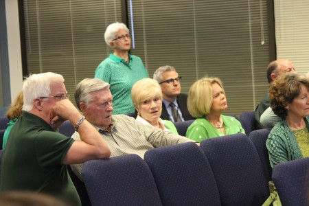 Dunwoody residents supporting renovation of Brook Run Theater wear green at the March 14 City Council meeting. (Photo Dyana Bagby)