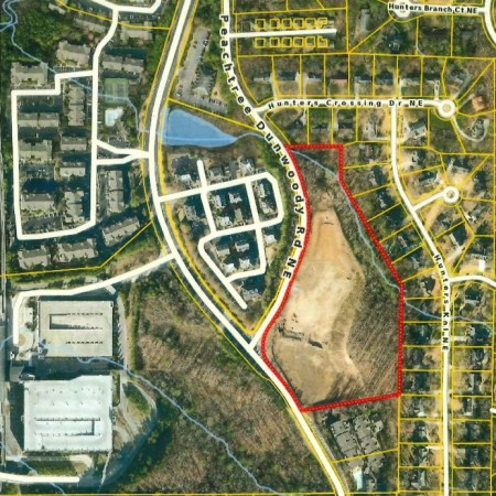 """A Fulton County property records map of the Trammell Crow Residential project site included in Sandy Springs City Council documents about the conservation easement. Peachtree-Dunwoody Road runs down the center of the map; the street labeled """"Peachtree Dunwoody Rd NE"""" has since been renamed Roberts Court."""