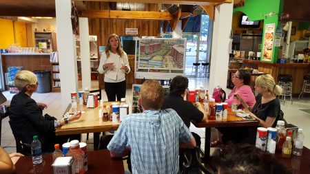 """At Plaza Fiesta on the Chamblee/Brookhaven border, MARTA's Amanda Rhein presents the transit agency's proposal for transit-oriented redevelopment around the Brookhaven/Oglethorpe station during the April 27 """"bus crawl."""" (Photo John Ruch)"""