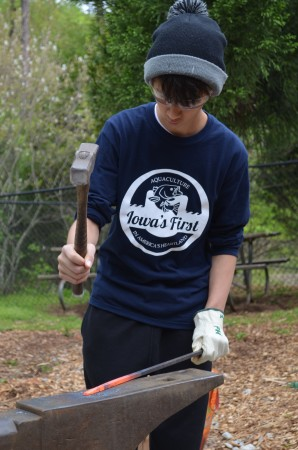 Parker Hollosi makes a point hammering a hot metal bar.