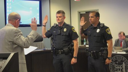 Mayor Denis Shortal swears in new Dunwoody Police officers Zach Woodburn (left) and Chris Valente. (Photo Dyana Bagby)
